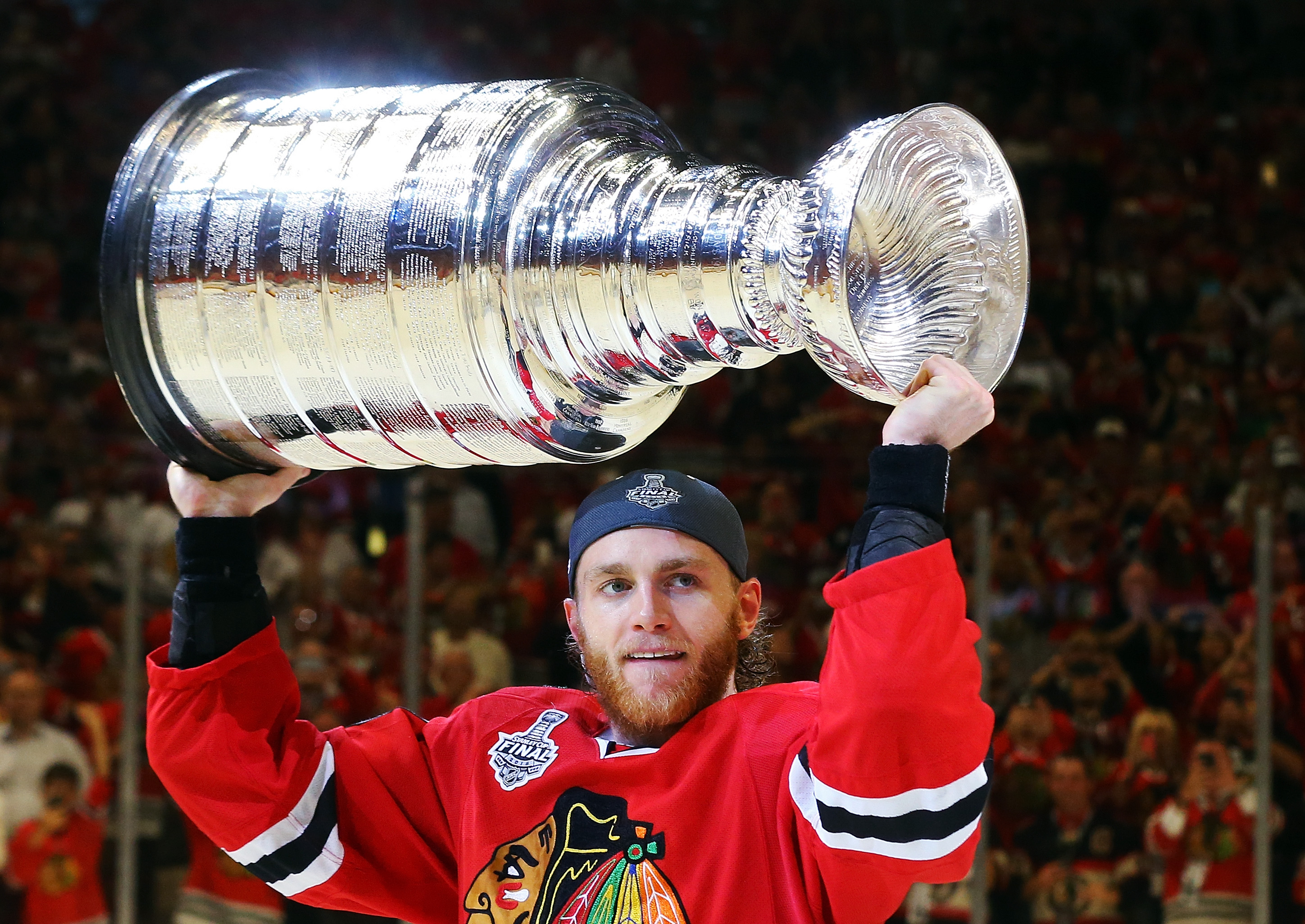 c4ee83a71 Patrick Kane celebrates by hoisting the Stanley Cup after defeating the  Tampa Bay Lightning