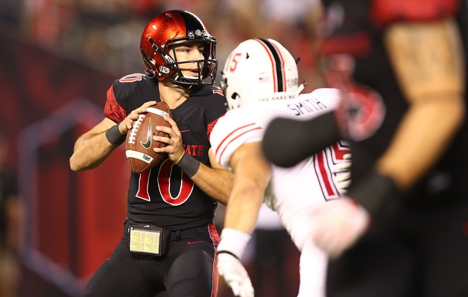Christian Chapman of the San Diego Aztecs is tackled by Sutton Smith of the Northern Illinois Huskies on Sept. 30, 2017 in San Diego, California.  (Photo by Joe Scarnici/Getty Images)