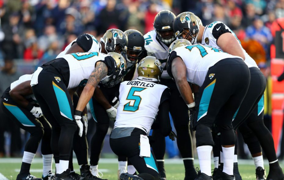 Blake Bortles #5 of the Jacksonville Jaguars huddles with teammates in the second quarter during the AFC Championship Game against the New England Patriots at Gillette Stadium on January 21, 2018 in Foxborough, Massachusetts.  (Photo by Adam Glanzman/Getty Images)
