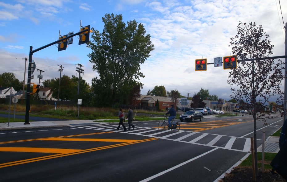 Bicyclist and pedestrians use a crosswalk controlled by a HAWK beacon at  Kenmore Avenue on the Tonawanda/Buffalo border. A similar device is set to start working Monday on Main Street in Williamsville.  (John Hickey/Buffalo News file photo)