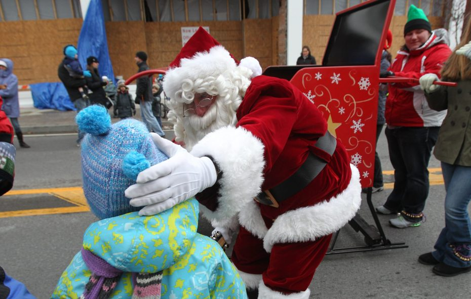 Santa greets children during his parade in 2012. (News file photo by Sharon Cantillon)