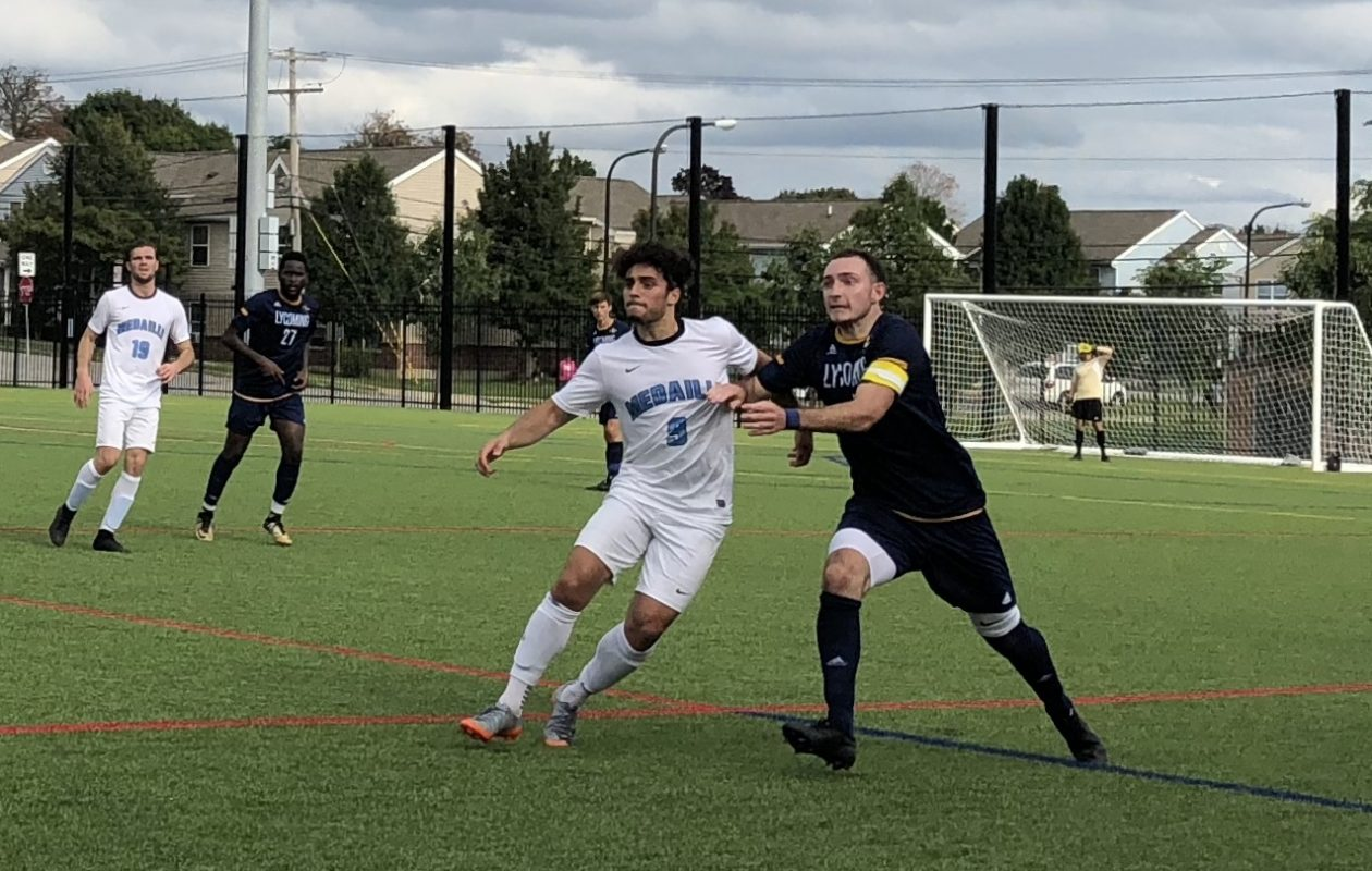 Anthony Marafioti, No. 9 in white, is an invaluable member of the Medaille men's soccer team. (Ben Tsujimoto/Buffalo News)