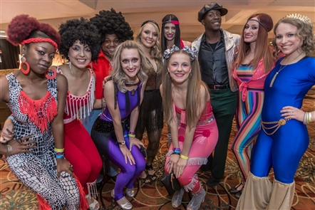 Plenty of 1970s attire -- like flashy pants, platform shoes and intensely bright clothing -- are a staple of the World's Largest Disco, which returns to the Buffalo Niagara Convention Center on the Saturday after Thanksgiving. Whet your appetite with these funky and fun photos.