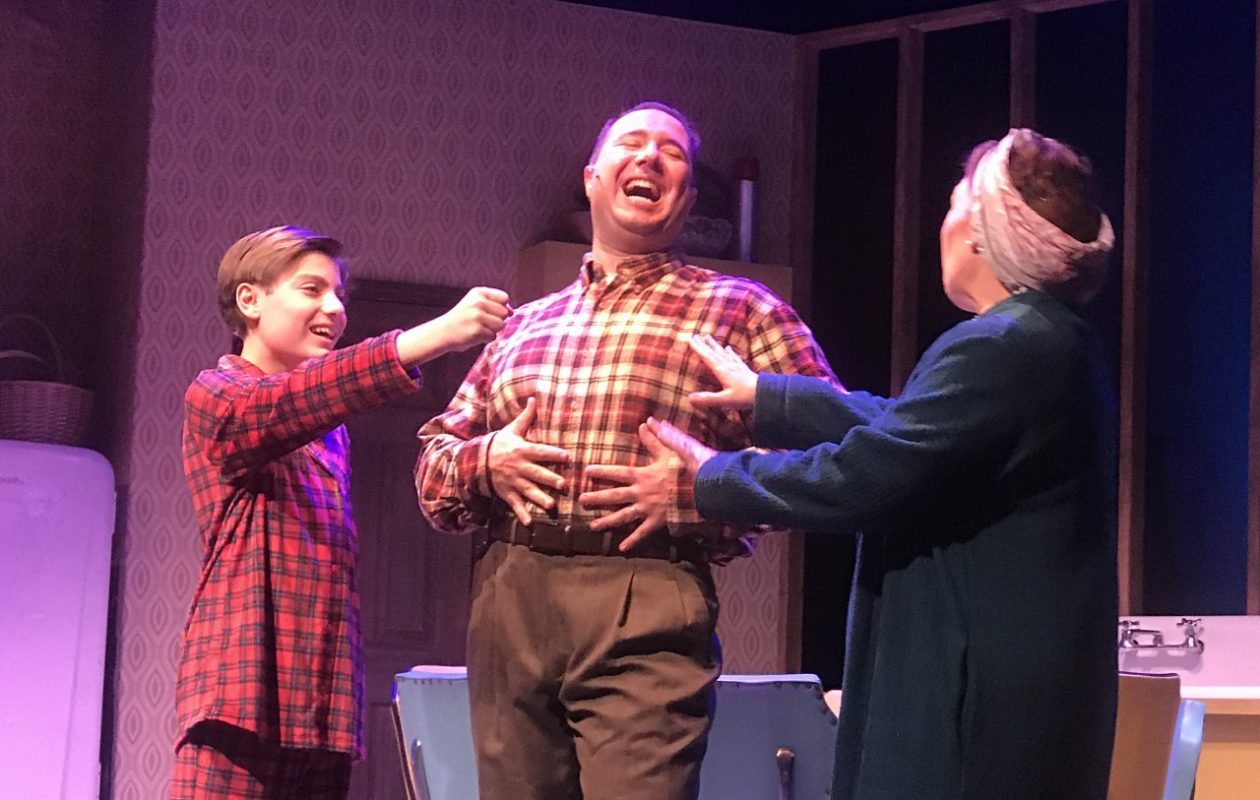 Michael Scime, Jacob Albarella and Wendy Hall star as members of the Pazinski family in the world premiere of 'Christmas Over the Tavern' at MusicalFare Theatre. (Photo by Doug Weyand.)