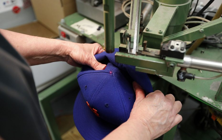 New Era Cap plans to close its factory in Derby in March, putting nearly all of its 219 employees there out of work. (Mark Mulville/News file photo)