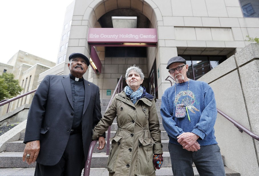 Four citizens who sued Erie County Sheriff Timothy B. Howard have won a court decision that forces him to report serious jail incidents accurately or face a contempt citation. Pictured here are the Rev. Eugene Pierce, Nan Haynes and Chuck Culhane. The fourth citizen, who is not in the photo, is Karima Amin. (Mark Mulville/Buffalo News)