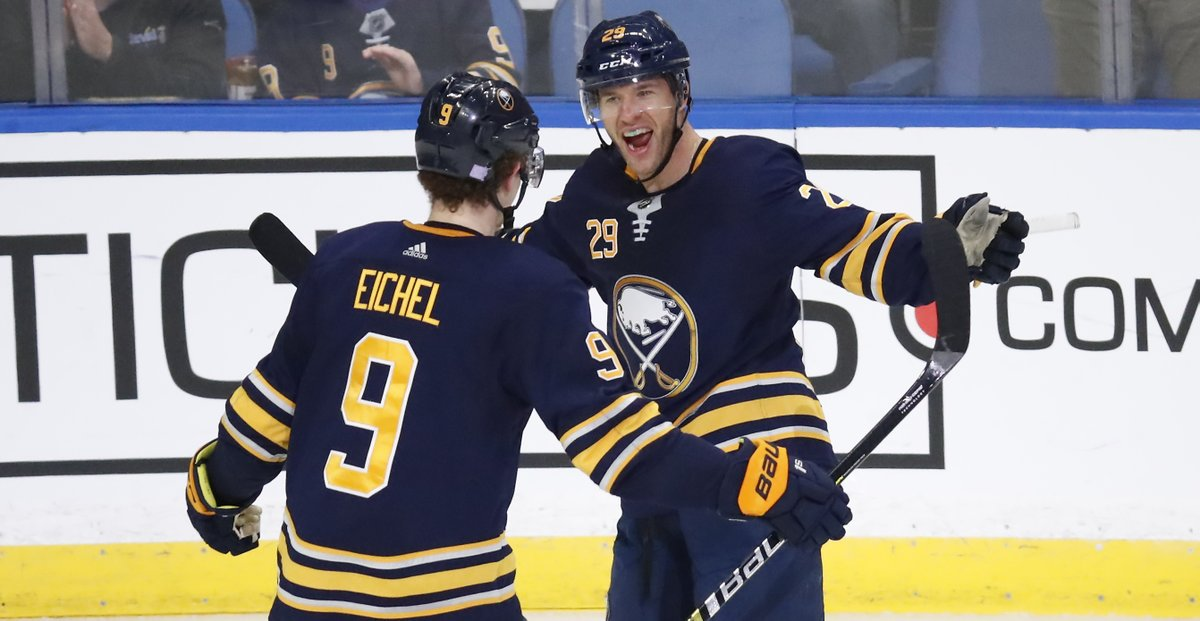 Jason Pominville celebrates his second goal of the game with Jack Eichel (Harry Scull Jr./Buffalo News).