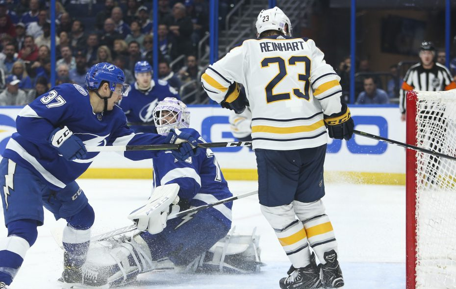 Tampa Bay Lightning center Yanni Gourde (37) and goaltender Louis Domingue (70) get beat as Buffalo Sabres center Sam Reinhart (23) scores to tie the game at 3-3 during second period action on Thursday. (Dirk Shadd/Tampa Bay Times/TNS)