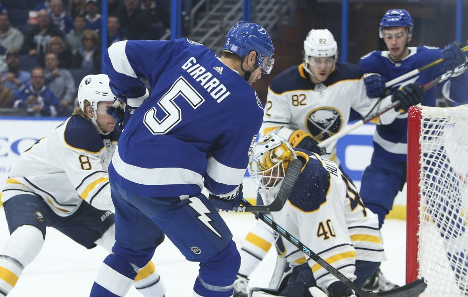 Tampa Bay Lightning defenseman Dan Girardi scores, beating Buffalo Sabres goaltender Carter Hutton for the first goal of the game during first period action on Thursday, Nov. 29, 2018 at Amalie Arena in Tampa, Fla. (Dirk Shadd/Tampa Bay Times/TNS)