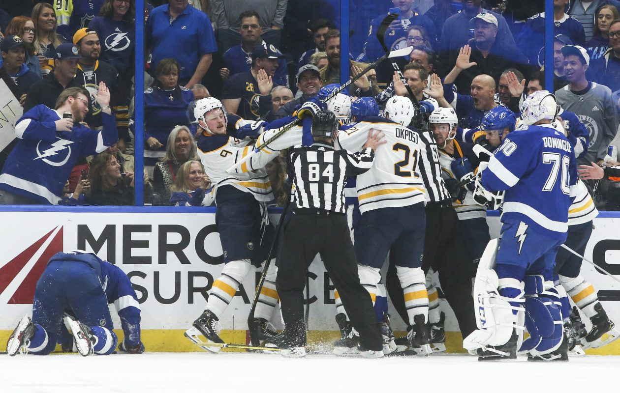 The sticks come up as a scuffle breaks out behind the Lightning net during a physical first period between the Tampa Bay Lightning and Buffalo Sabres. (Dirk Shadd/Tampa Bay Times/TNS)