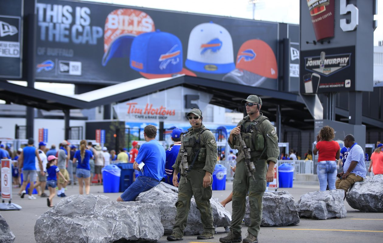 Erie County SWAT team members walk the outside perimeter of New Era Field. (Harry Scull Jr./News file photo)