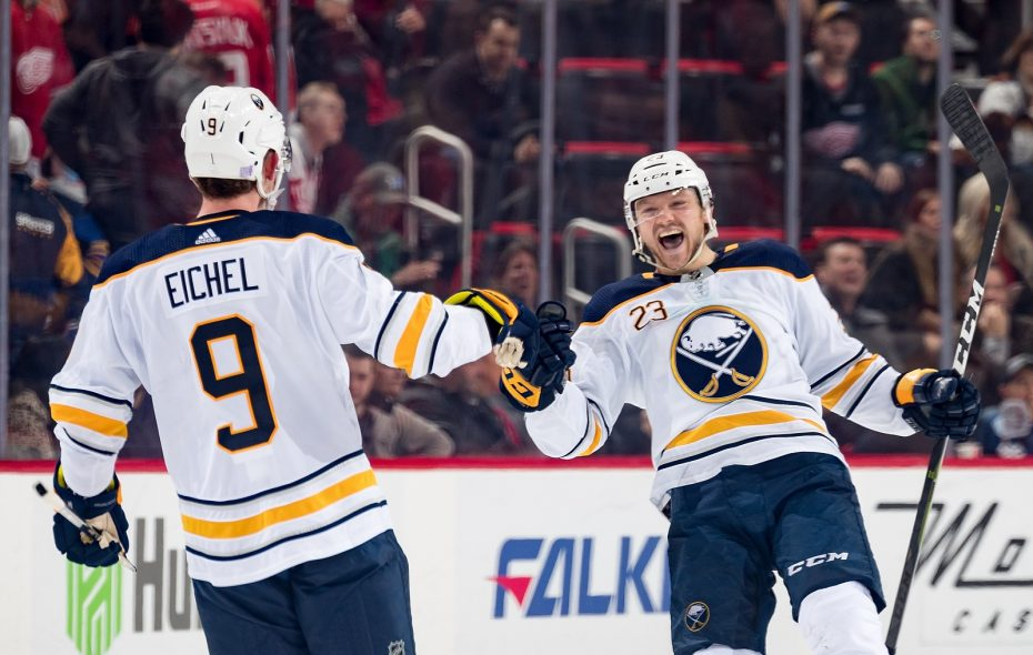 Sam Reinhart celebrates his game-winning shootout goal against the Detroit Red Wings with Jack Eichel. (Dave Reginek/NHLI via Getty Images)