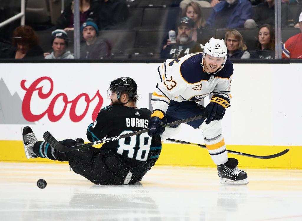 Sabres forward Sam Reinhart and Sharks defenseman Brent Burns battle for the puck during the teams' Oct. 18, 2018, meeting in SAP Center won by the Sharks, 5-1. (Getty Images)
