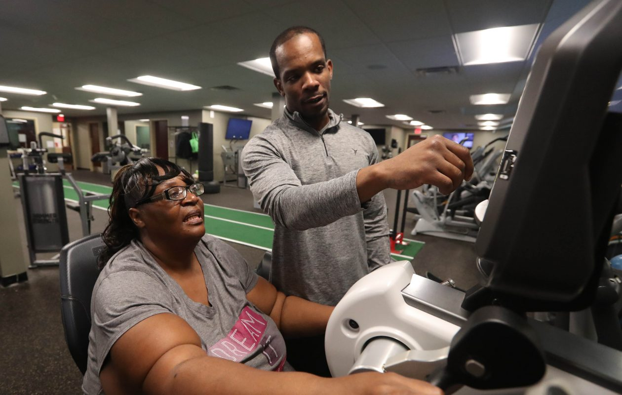 Sarah Burks, a patient at Urban Family Practice, has lost more than 40 pounds and brought her blood pressure under control thanks to the Greater Buffalo United Accountable Healthcare Network Wellness & Physical Fitness Program. Here she works with  personal trainer Andre Neal. (Sharon Cantillon/Buffalo News)