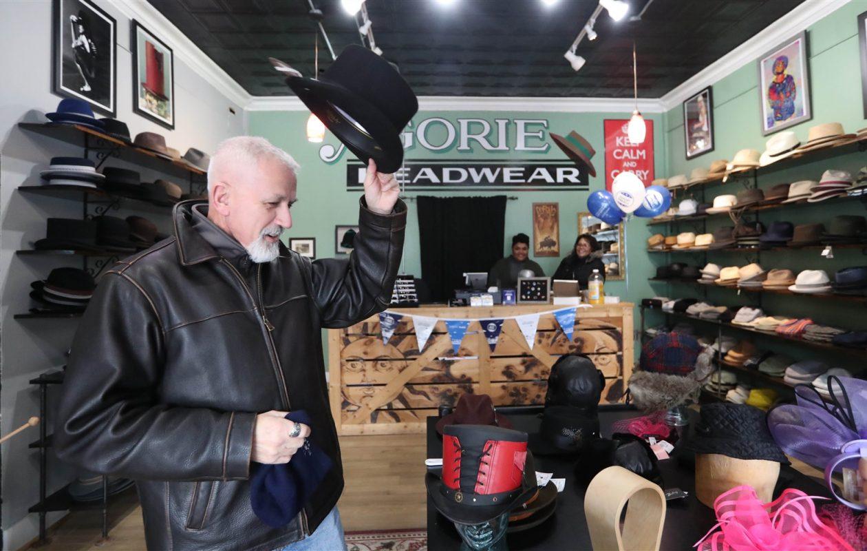 Carl Turchiarelli of Elma  tries on a hat at Agorie Headwear during Small Business Saturday. (Sharon Cantillon/Buffalo News)
