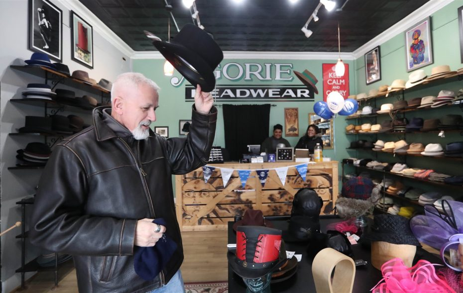 Carl Turchiarelli of Elma  tries on a hat at Agorie Headwear during Small Business Saturday. (Sharon Cantillon/Buffalo News)