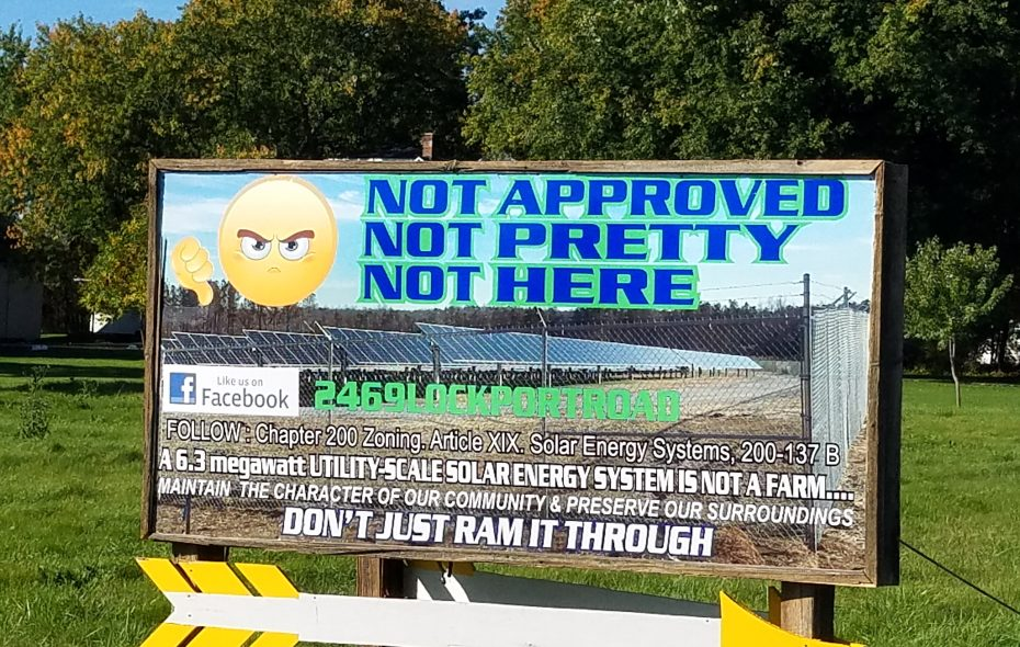 Opponents of a solar farm in Wheatfield posted this sign across the road from the site in the summer of 2018. (Thomas J. Prohaska/The Buffalo News)