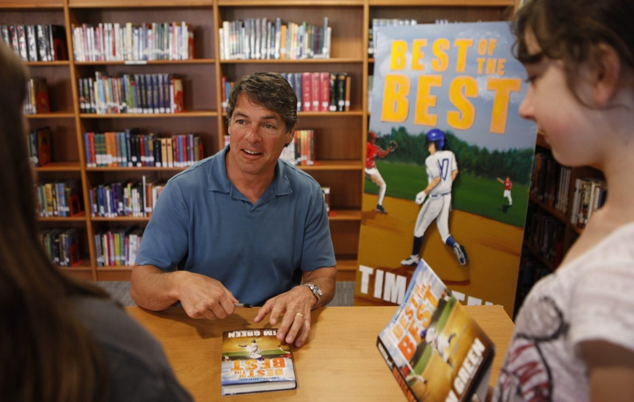 Tim Green signed copies of his book 'Best of the Best' for students at Depew Middle School in 2011. (Derek Gee / Buffalo News)