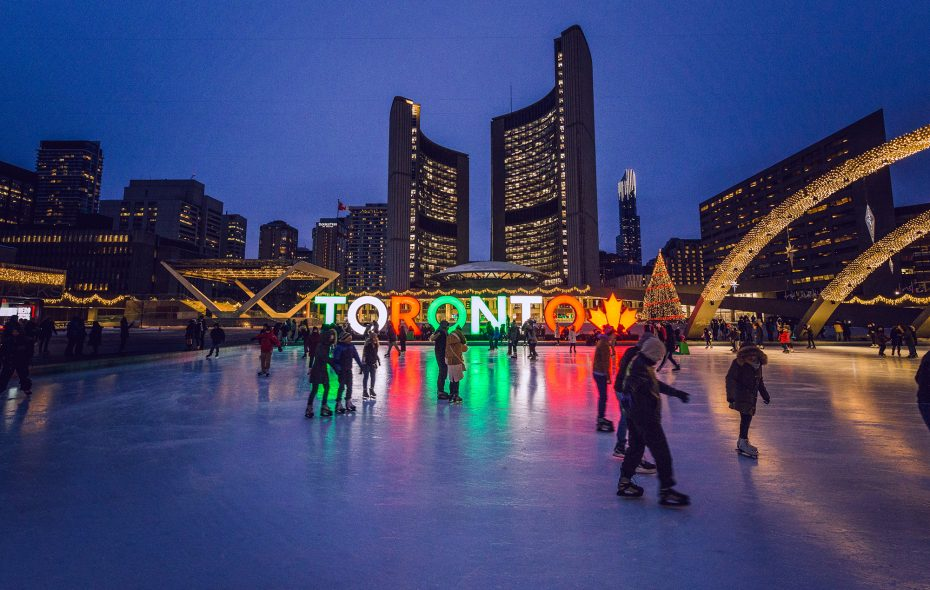 Beneath the twinkling arches of Nathan Phillips Square, skaters are treated to a stunning holiday lightscape at City Hall. (Tourism Toronto)