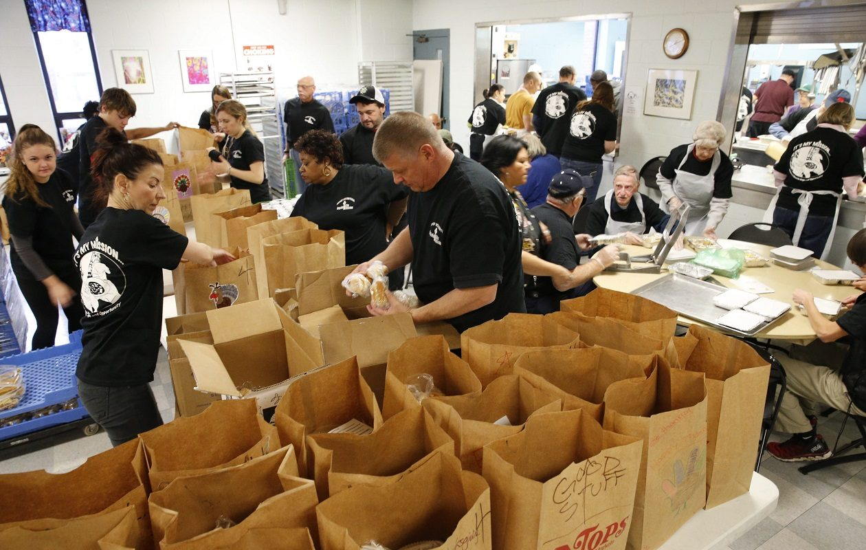 In this 2014 file photo, volunteers assemble Thanksgiving dinners to be delivered to those in need at the Buffalo City Mission.  (Derek Gee/News file photo)