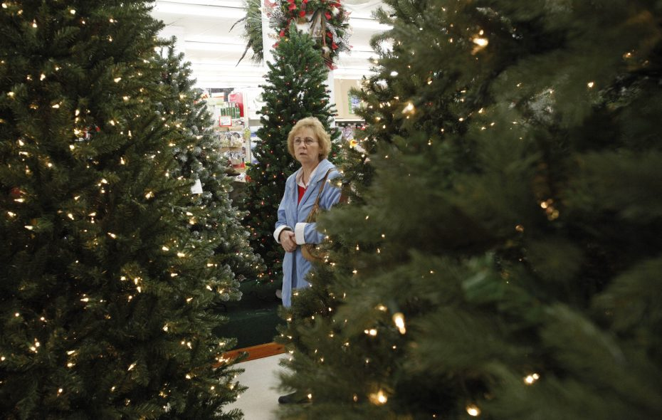 Marlene Walb of Bradford, Pa., looks for a Christmas tree at Dave's Christmas Wonderland. (Derek Gee/News file photo)