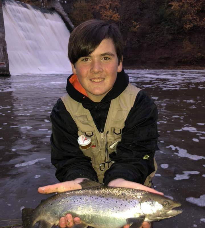 Ethan Bronschidle of Newfane caught his first Atlantic salmon last week while fishing a favorite Lake Ontario tributary.