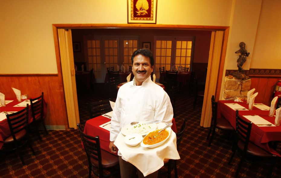 Taste of India owner Deep Singh, shown here in a 2011 photo, won a court order forcing Amherst police to return items taken in a raid as the department continues an investigation that involves Singh.  (Mark Mulville/News file photo)