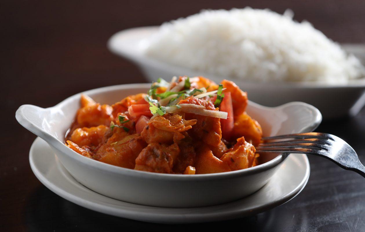 Kabab & Curry's gobi aloo is potatoes and cauliflower sauteed with chopped tomato and onion. (Sharon Cantillon/Buffalo News)