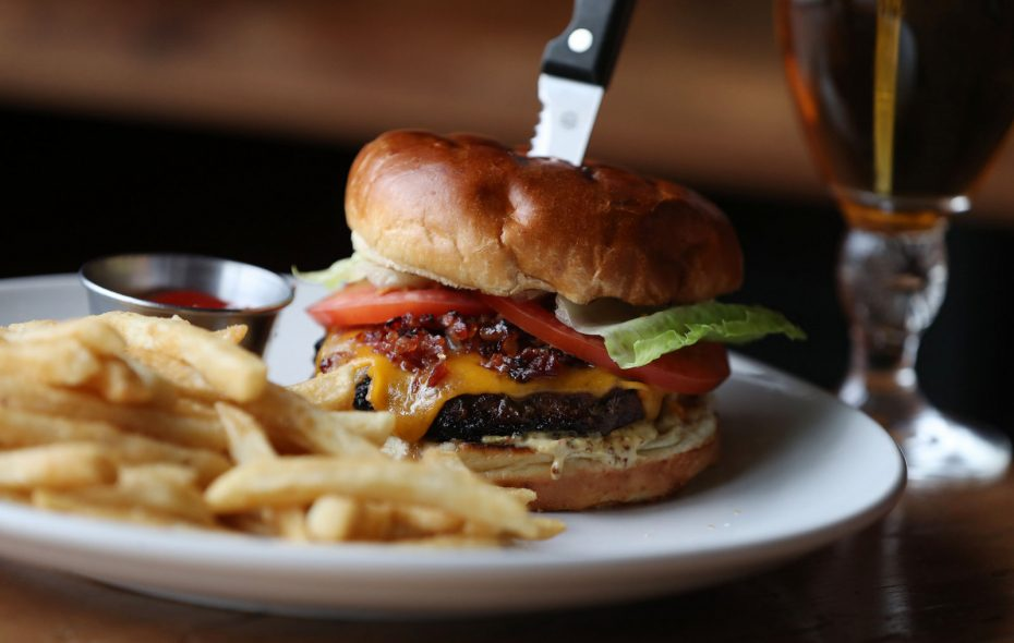 The Neat burger is topped with lettuce, tomato, cheddar, bacon jam and whiskey mustard. (Sharon Cantillon/Buffalo News)