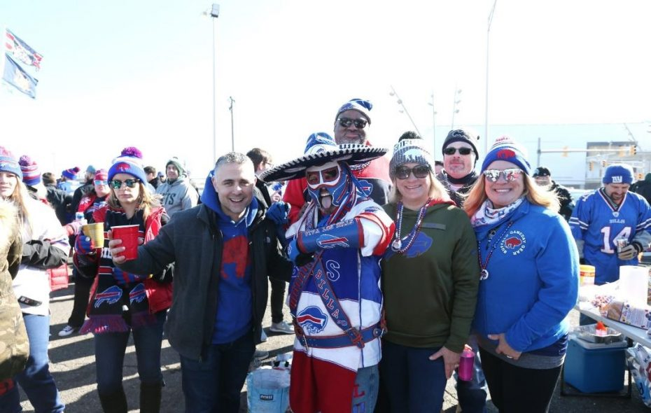 Ezra Castro, known among football fans as Pancho Billa, poses with other Bills loyalists during Pinto Ron's 400th consecutive tailgate party on Sunday at Met Life Stadium. (James P. McCoy/Buffalo News)