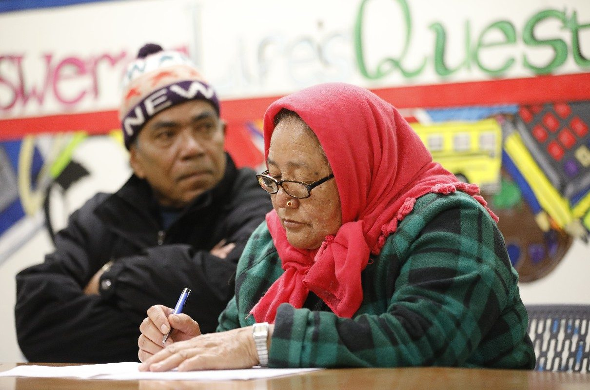 Bir Tamang, left, and Ratna Tamang participate in a presentation about power of attorney and health care proxy by attorney Erin Riker of the Center for Elder Law and Justice at the Hope Refugee Drop-In Center.  (Derek Gee/Buffalo News)