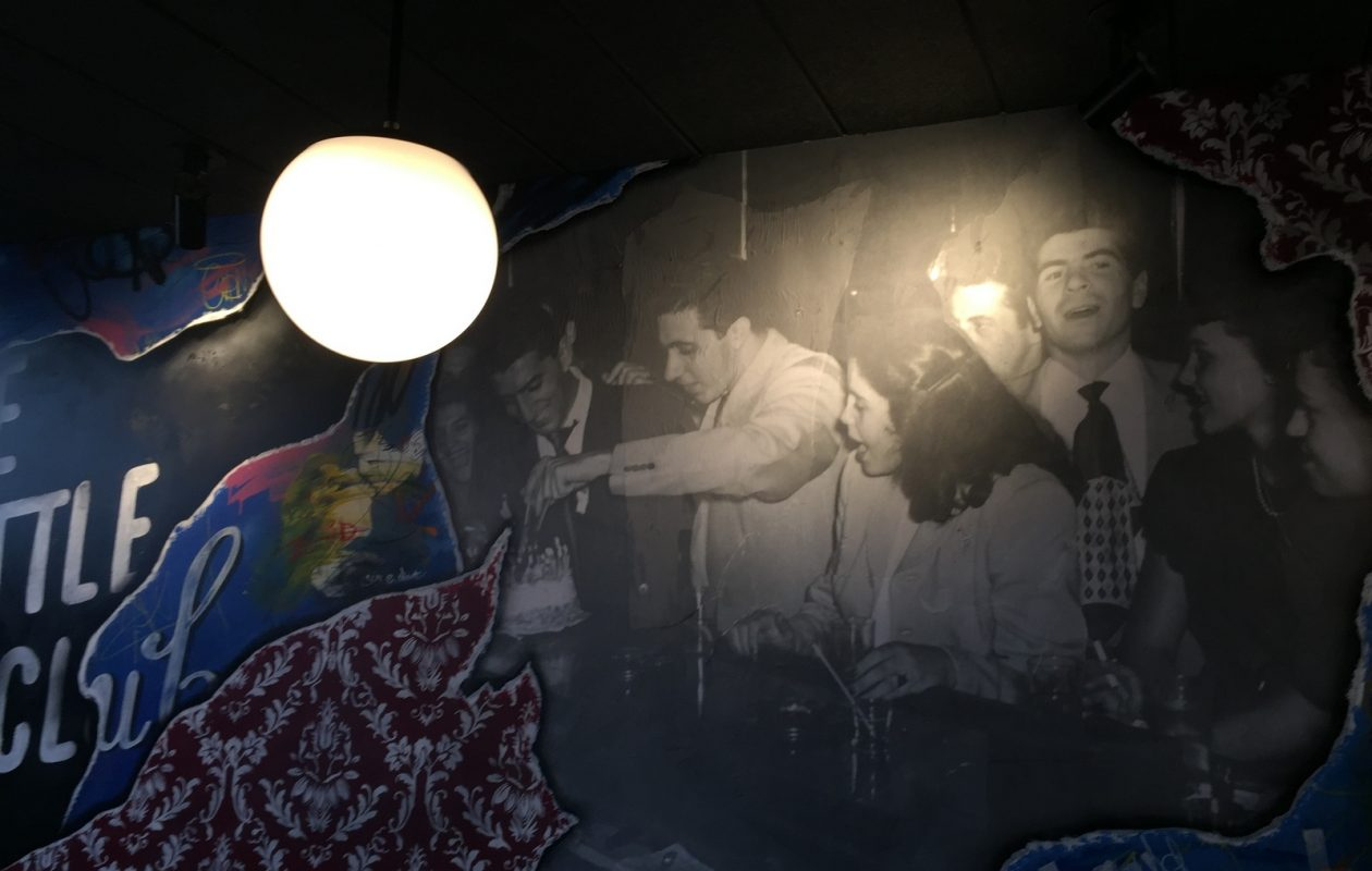 Artist Chuck Tingley incorporated a photograph from the original Lombardo spot, on the 700 block of Main Street, into a This Little Club mural. (Andrew Galarneau/Buffalo News)