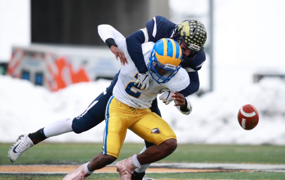 Cleveland Hill's Javon Thomas looses the ball after getting hit by a Susquehanna Valley defender. (Harry Scull Jr./Buffalo News)