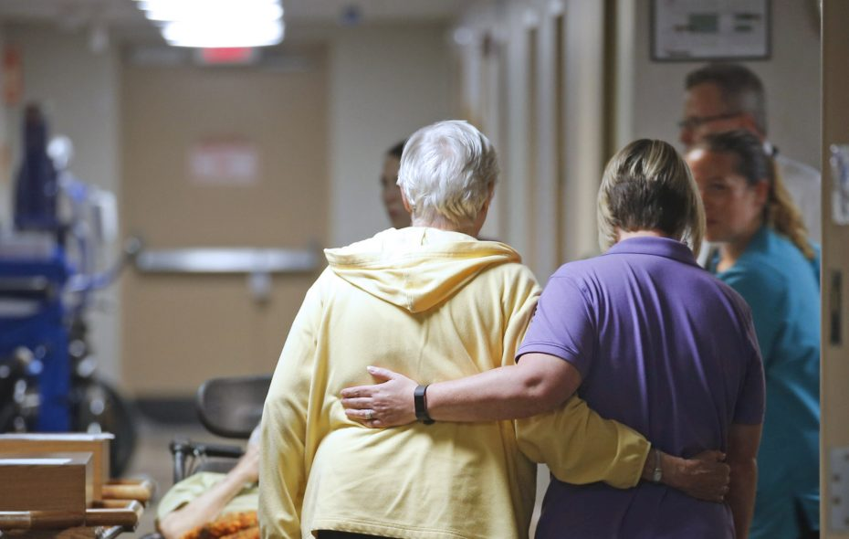 A resident is escorted down the hall at the Elderwood at Lancaster, a five-star nursing home near Buffalo. In 2017, poor people whose bills were paid by Medicaid represented only 1 percent of the nursing home's admissions. (Robert Kirkham/News file photo)