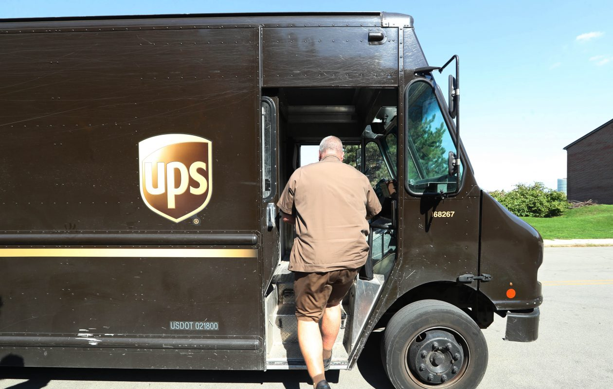 UPS agreed to pay $4.9 million to settle a probe by the EEOC's Buffalo office into whether its appearance policy discriminated against employees whose religious beliefs prevented them from complying. (Sharon Cantillon/News file photo)
