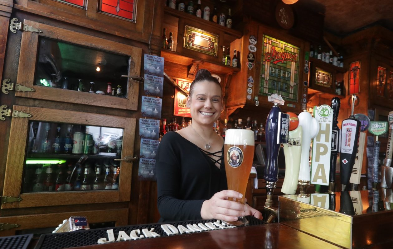 Rachelle Toledo, bar manager at Ulrich's 1868 Tavern, serves a beer. (John Hickey/Buffalo News)