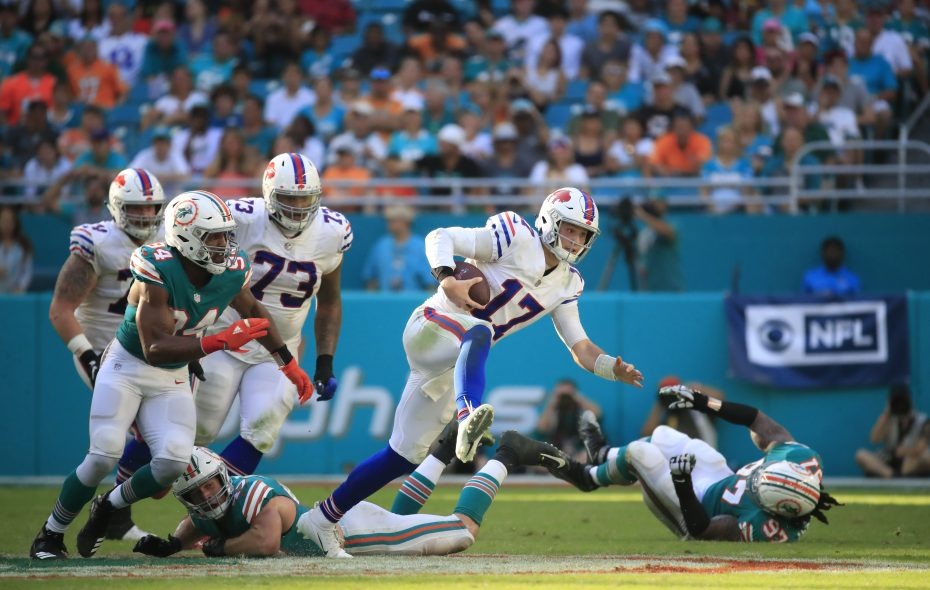 Josh Allen runs against the Dolphins during the fourth quarter. (Harry Scull Jr./Buffalo News)