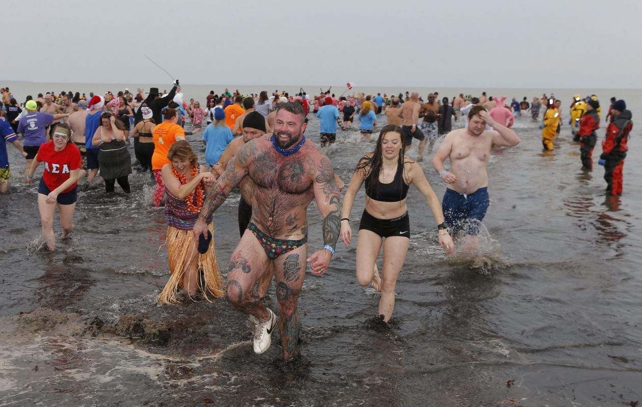Participants splash in the frigid water during the 12th annual Special Olympics Polar Plunge at Woodlawn Beach in Hamburg on Saturday. (Robert Kirkham/Buffalo News)