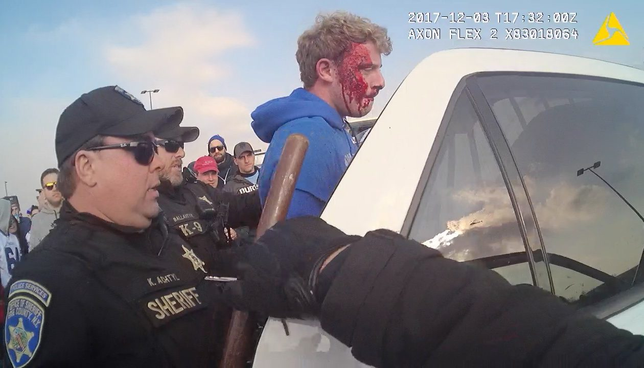 A still frame from footage by an Erie County Sheriff body camera shows Deputy Kenneth P. Achtyl, left, arresting Nicholas H. Belsito, right, for cursing at him outside during an incident outside New Era Field.