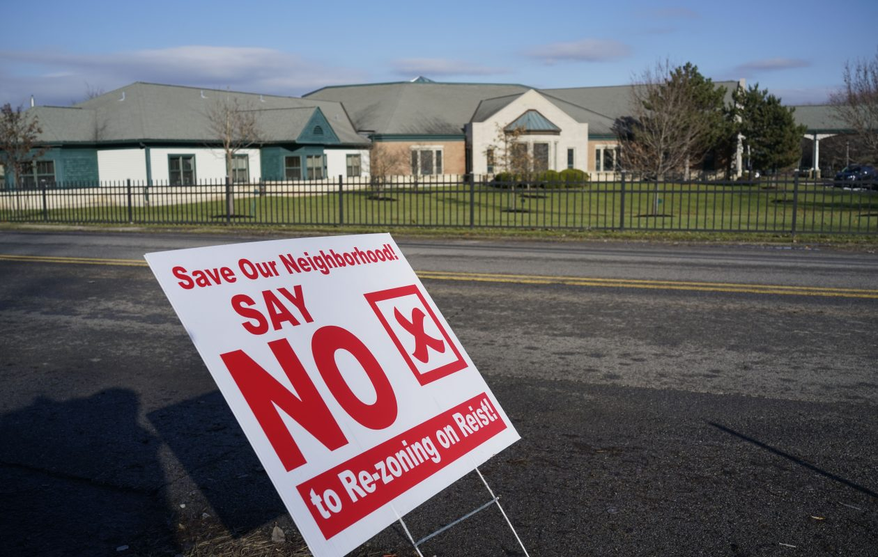 A sign opposing rezoning across the street from the St. Mary of the Angels regional house at 201 Reist St. in Amherst. (Derek Gee/Buffalo News)
