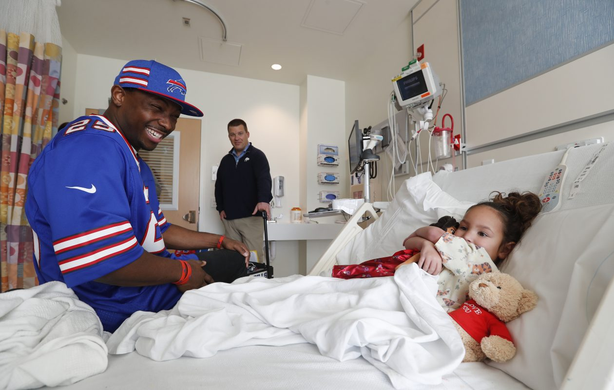 Buffalo Bills running back LeSean McCoy has a laugh with Cristaly Valentin during a visit at the Oishei Children's Hospital in Buffalo Tuesday, December 4, 2018.    (Mark Mulville/Buffalo News)