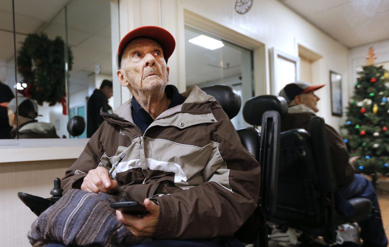 John Flickner, 78, waited hours in the lobby of Niagara Towers after he was evicted for using medical marijuana. He has a prescription for the drug. (Robert Kirkham/Buffalo News)