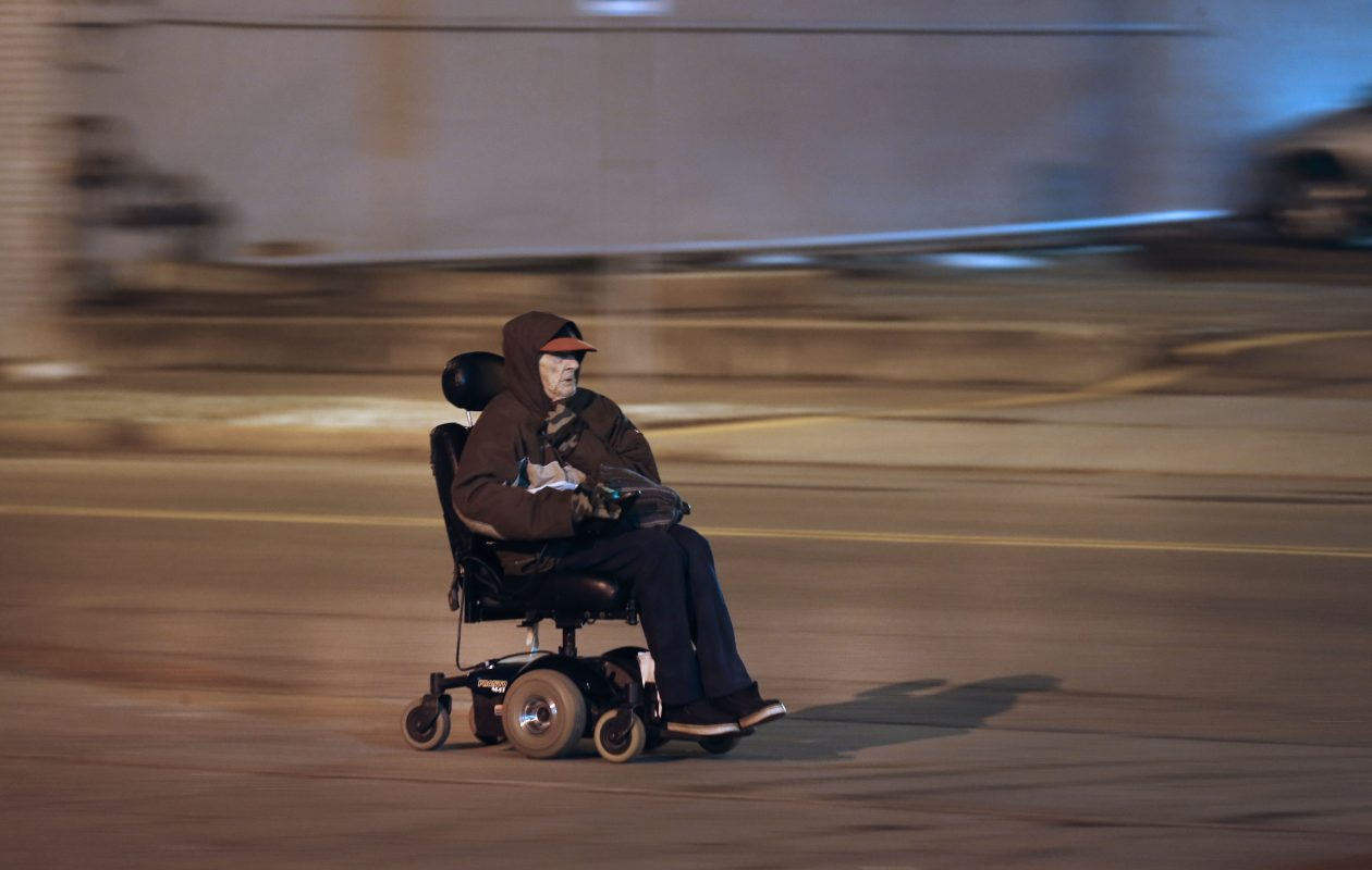 78-year-old John Flickner used his motorized wheelchair to get to the Niagara Gospel Rescue Mission on Portage Road after he was evicted from his Niagara Towers apartment. (Robert Kirkham/News file photo)