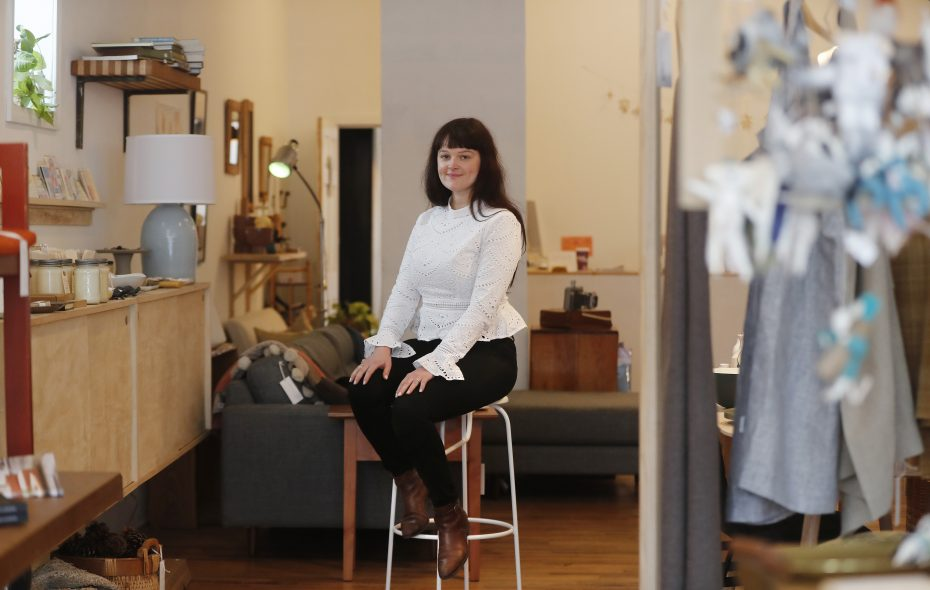 Hayley Carrow-Janecki wearing eyelet at her home decor shop, Ró, on Elmwood Avenue.     (Mark Mulville/Buffalo News)
