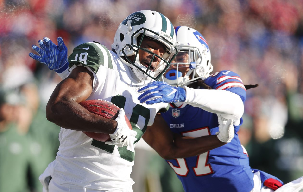 New York Jets' Andre Roberts is knocked out of bounds after a long run by Bills' Denzel Rice in the second quarter Sunday. (Mark Mulville/Buffalo News)