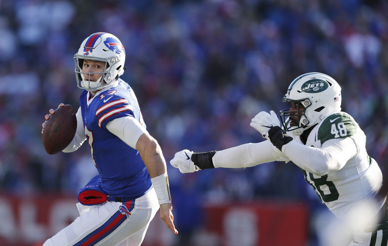 Bills' Josh Allen gets past Jets' Jordan Jenkins and runs for a touchdown. (Mark Mulville/Buffalo News)