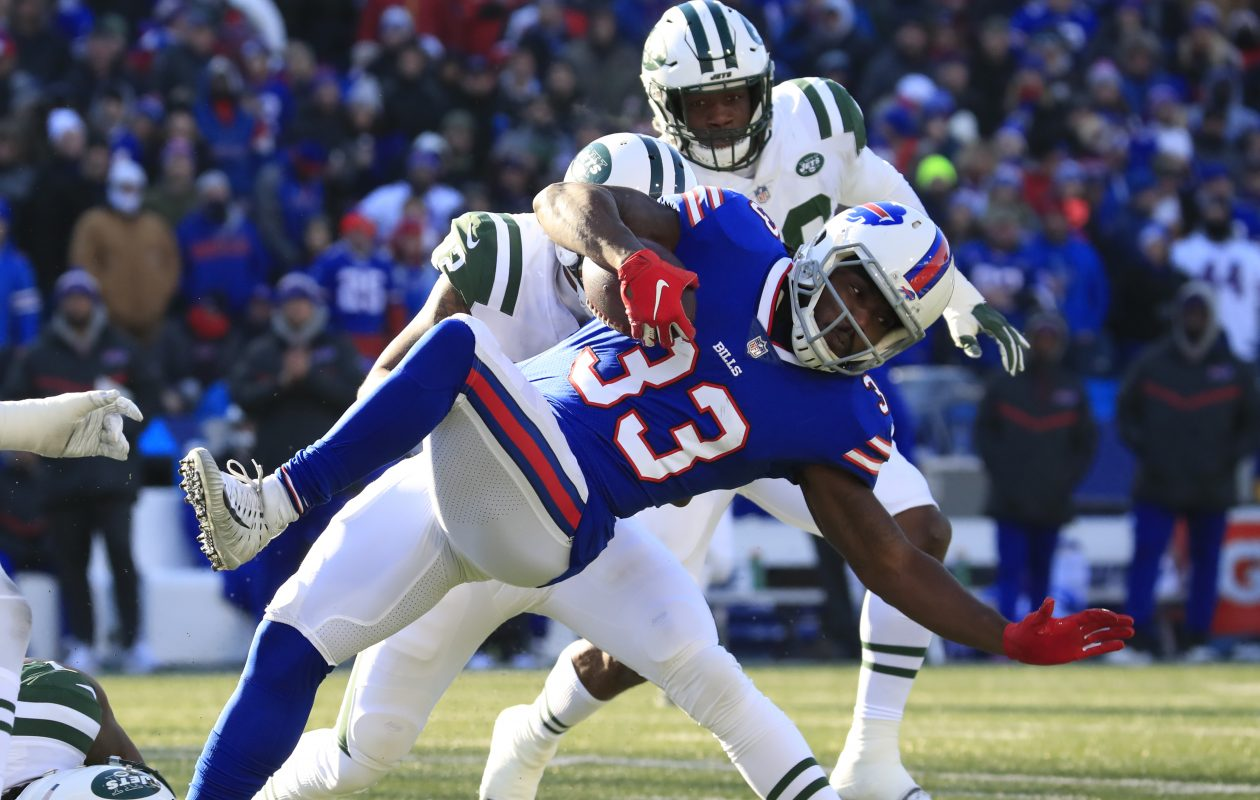 Bills running back Chris Ivory fights for yards against the New York Jets  (Harry Scull Jr./ Buffalo News)