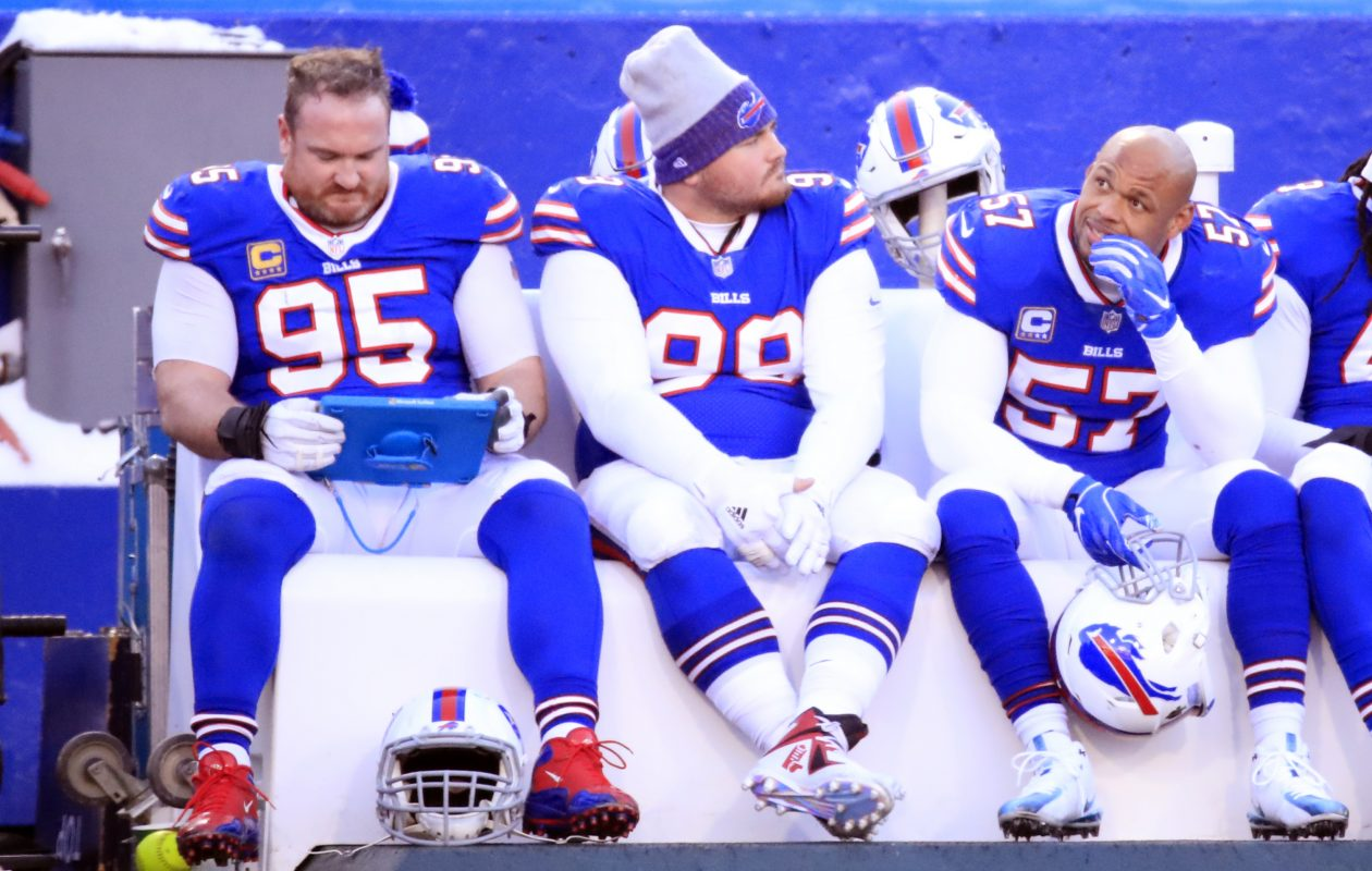 Buffalo Bills defensive players Kyle Williams, Harrison Phillips and Lorenzo Alexander look on from the bench against the New York Jets (Harry Scull Jr./ Buffalo News)