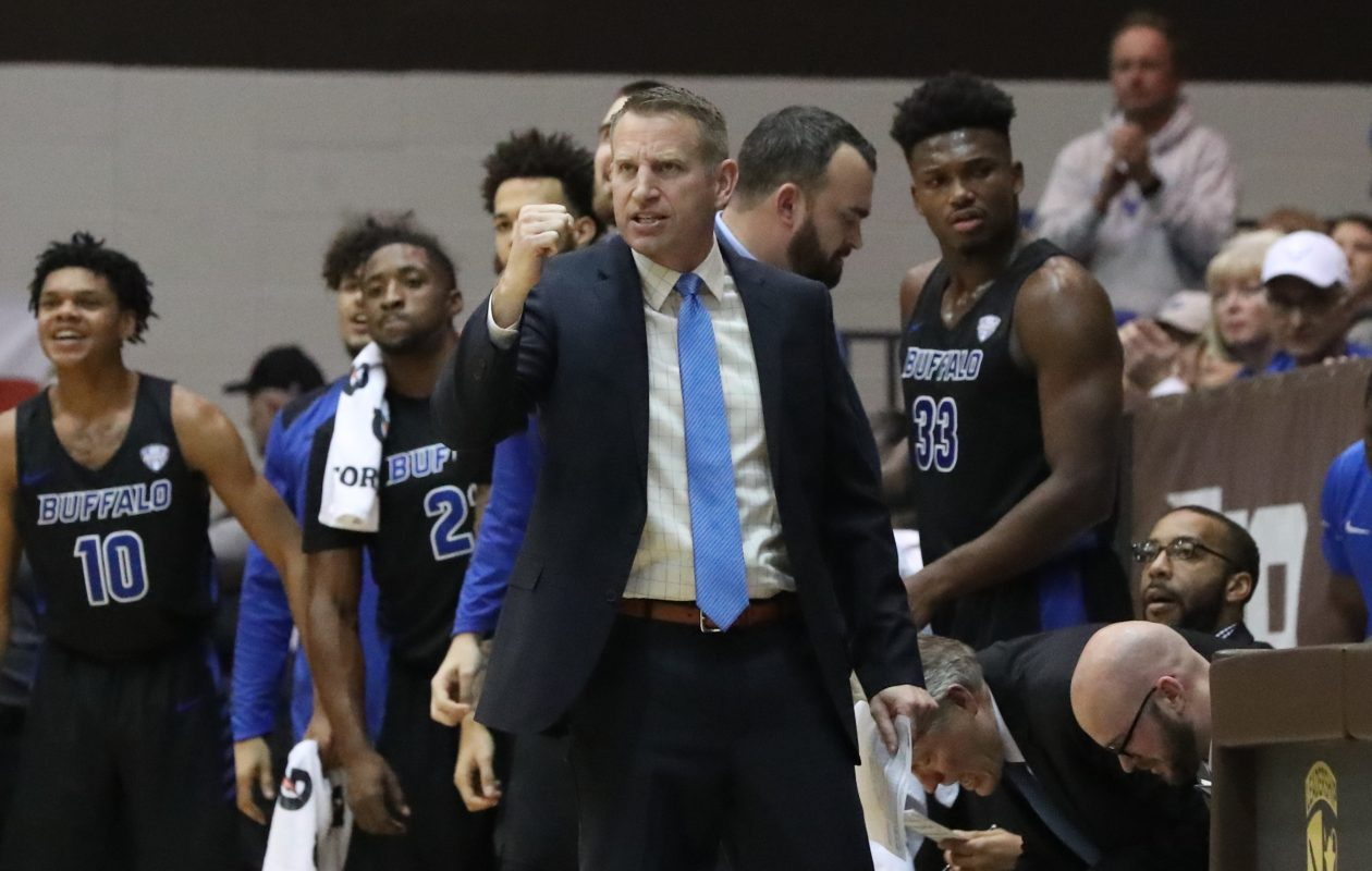 Bulls head coach Nate Oats celebrates a three-point basket by his team in the first half at St. Bonventure's Reilly Center. (James P. McCoy/News file photo)