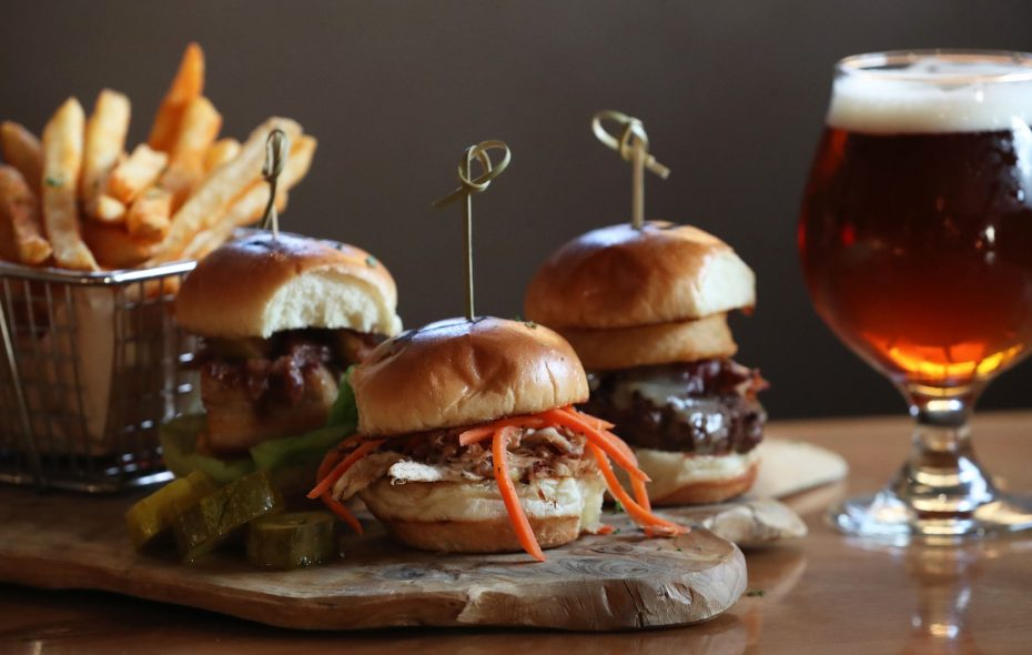 """""""100 Acre Wood"""" slider trio is made up of the Piglet, left, Rabbit, center and the Kanga, right. The Piglet is garlic-honey pot glazed crispy pork belly, baked sliced apple, brie and bibb lettuce. The Rabbit is braised rabbit, local chevre, pickled carrots and cumin aioli. The Kanga is ground kangaroo, white cheddar, applewood smoked bacon, onion ring and smoked paprika aioli. (Sharon Cantillon/Buffalo News)"""